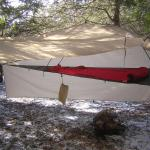 Fly and Skirt tied out as side porch.  Gear can be hung at various spots around the perimeter, and is even somewhat weather-protected just laying under the tent's footprint.